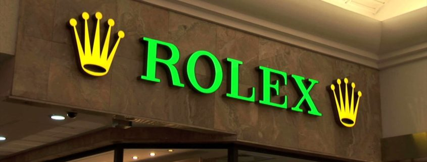 logo and image of rolex shop